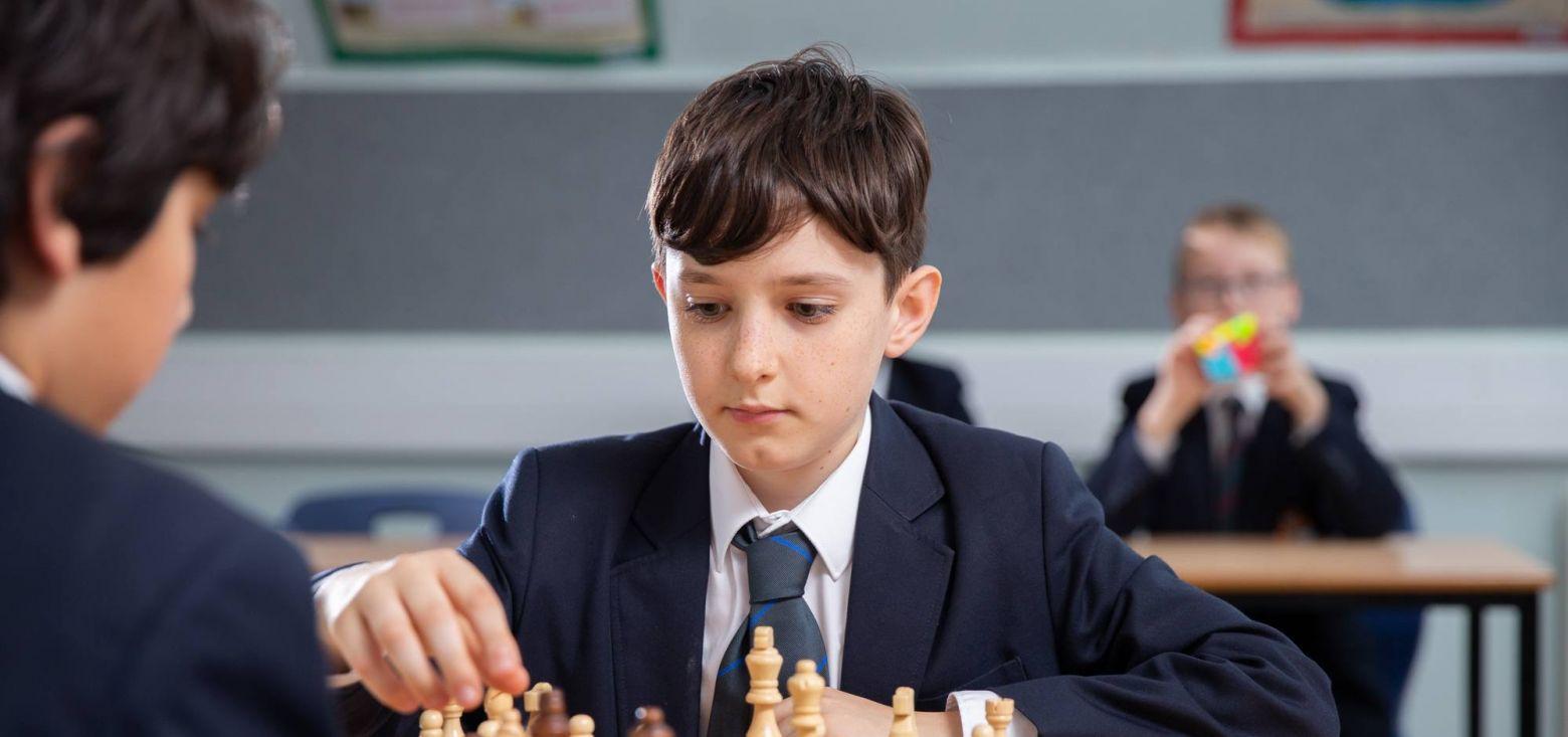 school children playing chess