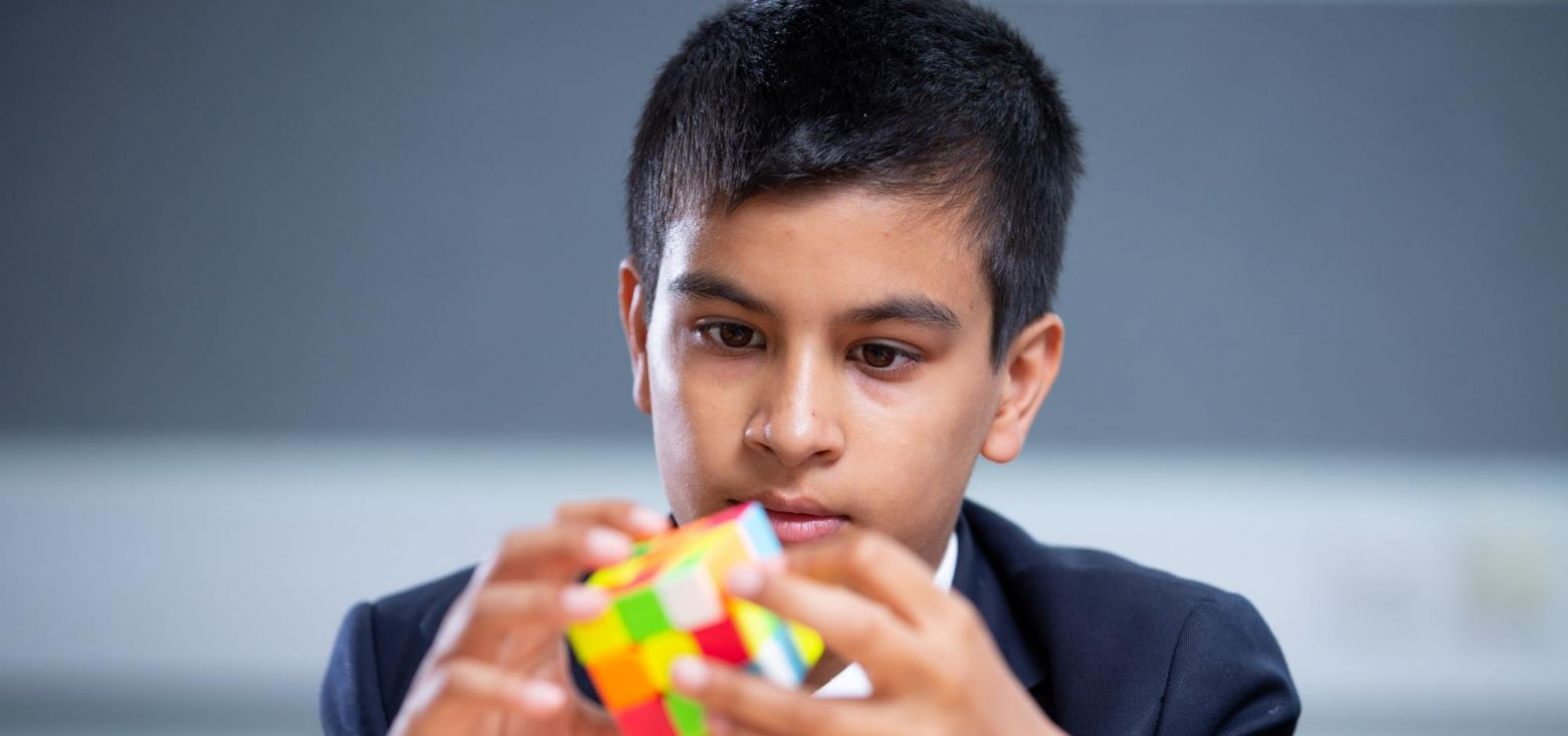 boy playing with a Rubik's cube