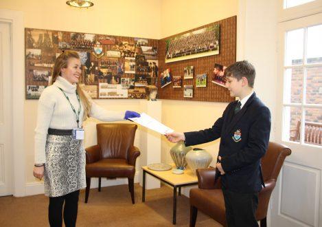 Teacher handing student exam results