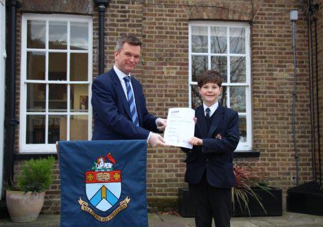 Halliford School boy with LAMDA Exam award
