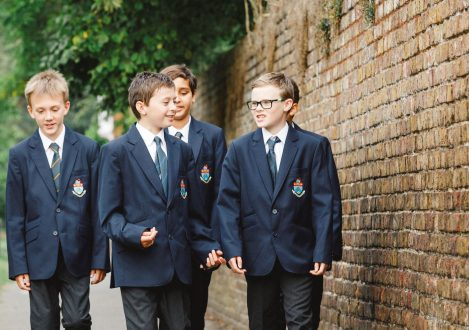 A group of young students walking to Halliford School